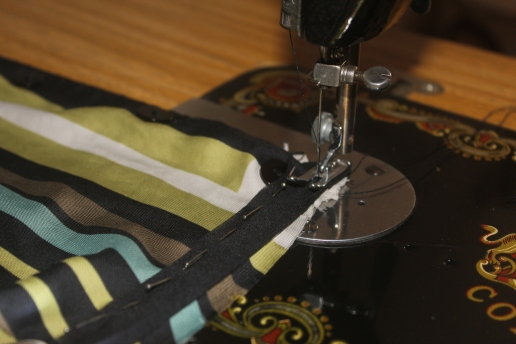 Hemming the neckline with black bias tape